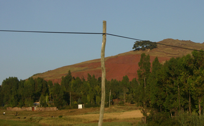 PHOTO BY JERRY SCHARF Red clay hills outside of Addis Ababa, Ethiopia.