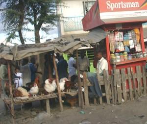 PHOTO BY JERRY SCHARF.  A chicken vendor in Nairobi, Kenya.